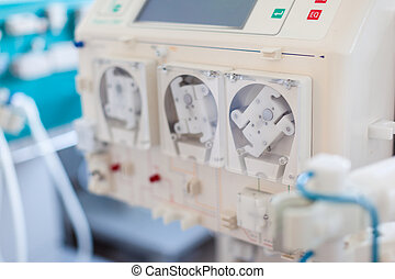 Dialyser pump - a dialyser or hemodialysis machine in an...