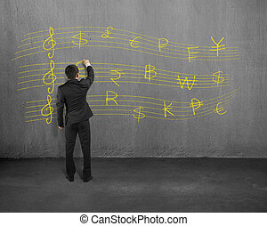 Sketching money stave on concrete wall - Businessman...