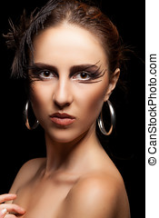 Woman with art fashion make up on black background Studio...