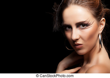 Woman with feather and goth make up Fashion art concept...