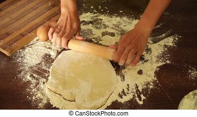 Closeup of woman making dough