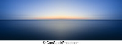 Stunning long exposure seascape image of calm ocean at...