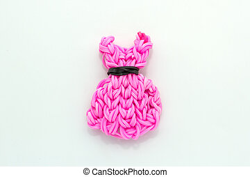 Pink elastic rainbow loom bands dress shaped on white...