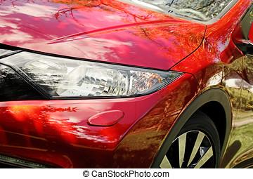 closeup of modern red sport car headlight