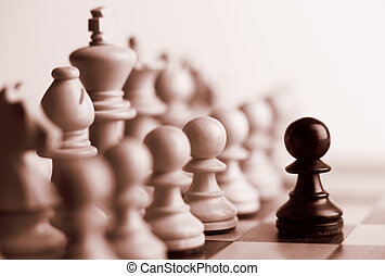 Black pawn and white chess pieces