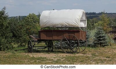 A side view of a stagecoach that was from the old west.