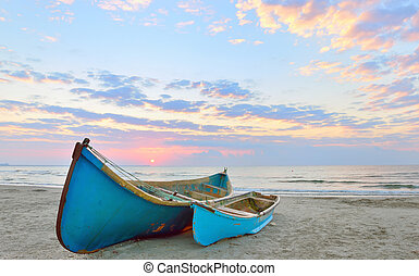 Fishing boats and sunrise on Black Sea beach