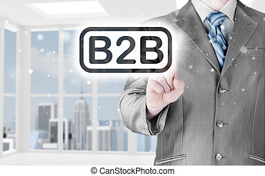 businessman pointing to word B2B, business-to-busines s,...