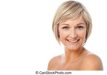 Smiling woman ready for make-up - Attractive middle aged...