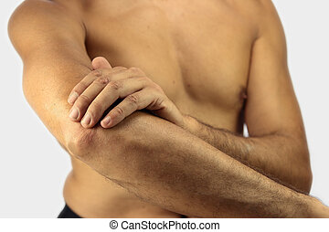 Elbow Pain - man affected by Tennis elbow or lateral...