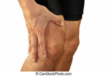 knee pain - Male runner having knee problems during exercise