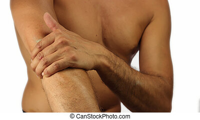 Elbow Pain - Male runner using therapeutic clay on his elbow