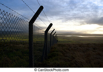 barbed wire fencing and scenic view - barbed wire fencing...