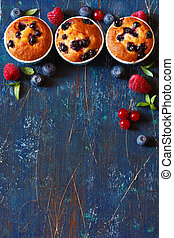 Muffins. - Sweet muffins and fresh berries background for...