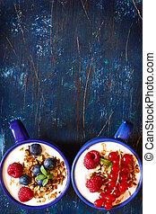 Breakfast. - Yogurt with granola and fresh berries on an old...
