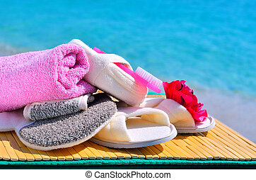 Natural bath sponges, bath slippers, pumice and towel...