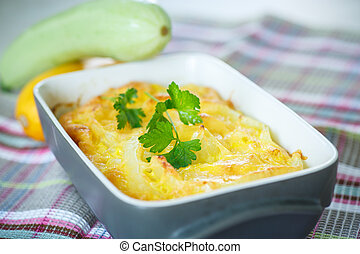 zucchini casserole - casserole with cheese and zucchini in...