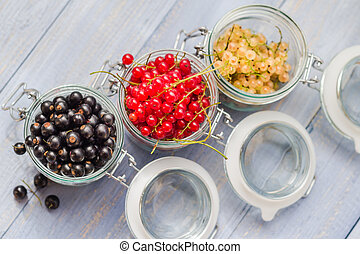 colorful currant fruit jars wooden table - Colorful currant...