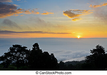 Colorful sunrise above the clouds from high mountain at...