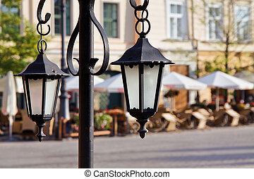 Town market cafe in Cracow with lanterns