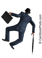 businessman jumping and kicking his heels isolated on white...