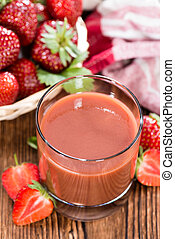 Fresh made Strawberry Juice on dark wooden background (with...
