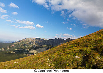 view on mountais in summer and blue sky with clouds