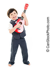 Boy playing ukulele - Handsome boy in a grey suit and on...