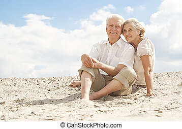 Attractive elderly people enjoy the sea breeze - Amusing...