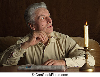 Elderly man reading newspaper - Elderly beautiful man...