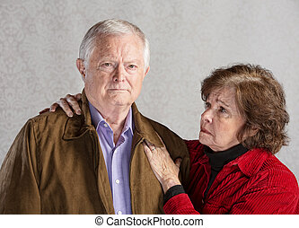 Concerned Senior Couple - Concerned senior husband and wife...