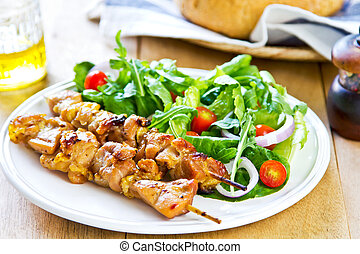 Grilled chicken skewer with salad - Grilled chicken skewer...