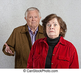Startled Woman Near Man - Stiff older woman in front of...