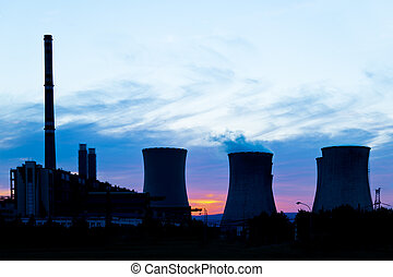 silhouette of power plant - a silhouette of power station at...