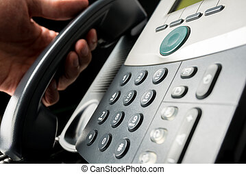 Global communications - Closeup of landline office telephone...
