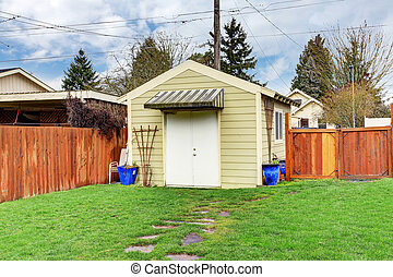 House backyard with shed - Fenced backyard with small shed
