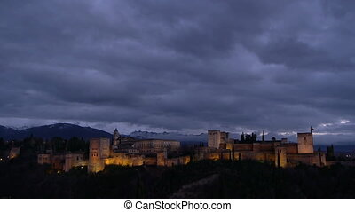 Alhambra and Sierra Nevada - Alhambra at sunset with yellow...