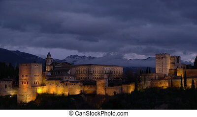 Alhambra at sunset with yellow lights