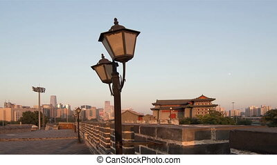 The sun goes down at the turret of Palace Museum, Beijing,...