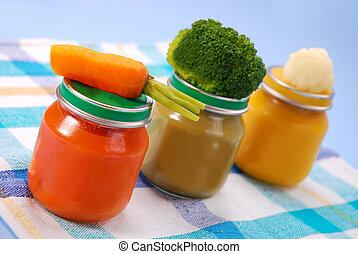 baby food in jars - three jars of vegetables puree as baby...