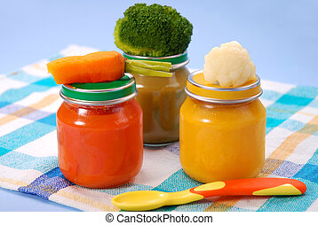 baby food in jars - three jars of vegetables puree as baby...