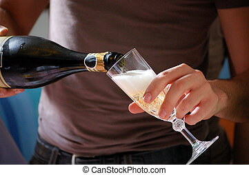 serving champagne - A man is serving champagne in a crystal...