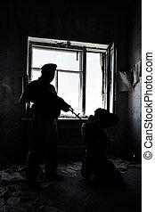 hostage taking - Backlit image of soldier guarding a hostage