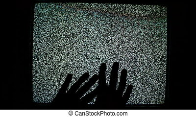 Male hands crawling up TV screen - Male hands crawling up...