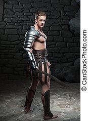 Gladiator with sword posing - Full length side view portrait...