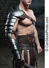 Gladiator with sword posing - Closeup portrait of young...