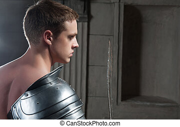 Gladiator from behind - Closeup portrait of young attractive...