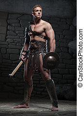 Gladiator with shield and axe - Full length portrait of...