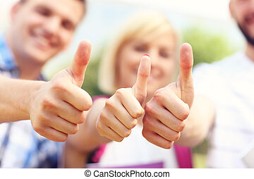 Students showing ok sign - A picture of a group of students...