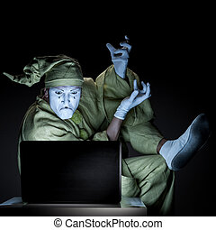 mime on internet - funny mime sitting near laptop and show...